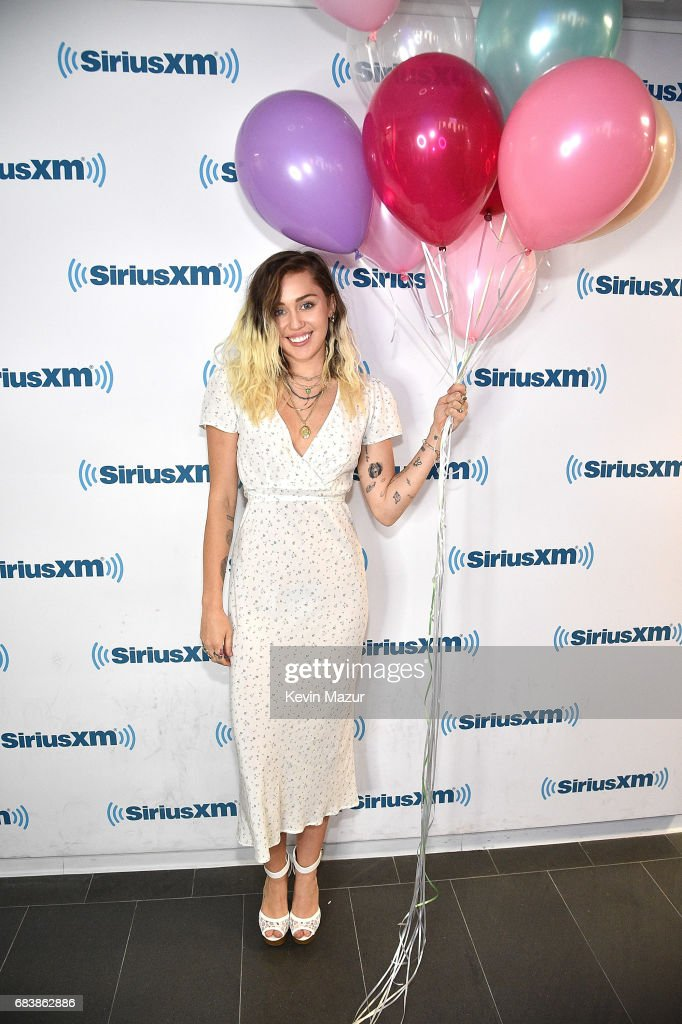Miley Cyrus poses at SiriusXM Studios on May 16, 2017 in New York City.