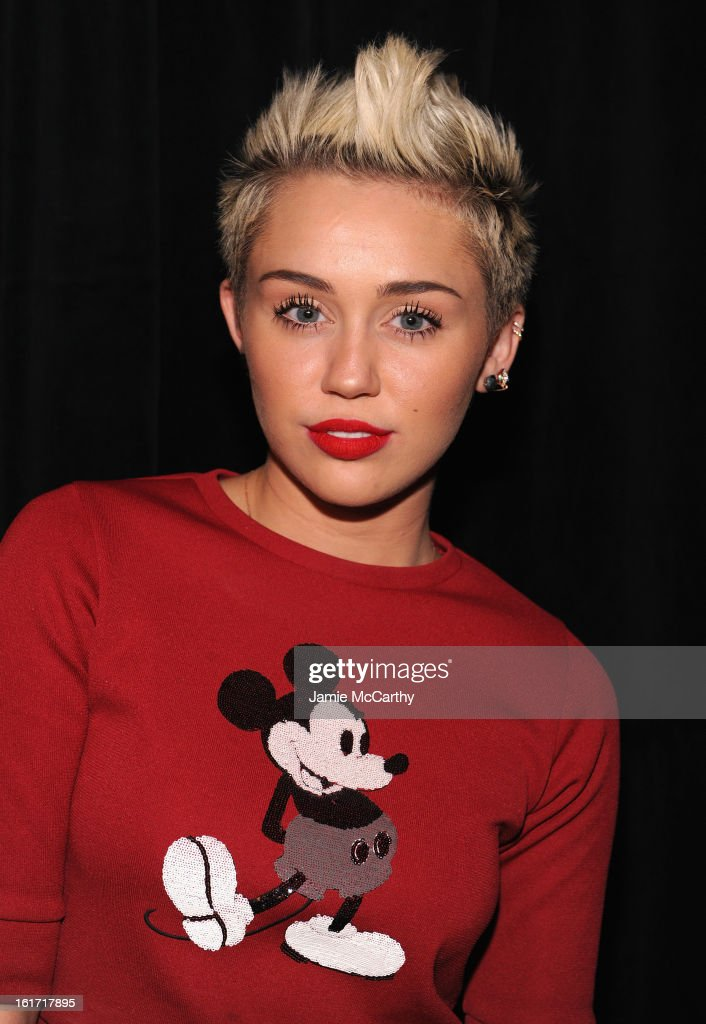 <a gi-track='captionPersonalityLinkClicked' href=/galleries/search?phrase=Miley+Cyrus&family=editorial&specificpeople=3973523 ng-click='$event.stopPropagation()'>Miley Cyrus</a> poses backstage at the Marc Jacobs Collection Fall 2013 fashion show during Mercedes-Benz Fashion Week at New York Armory on February 14, 2013 in New York City.