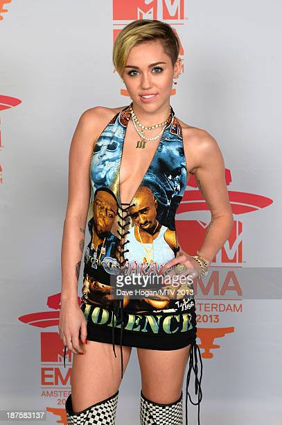 Miley Cyrus poses in the Exclusive Arrivals Studio during MTV EMA's 2013 at the Ziggo Dome on November 10 2013 in Amsterdam Netherlands