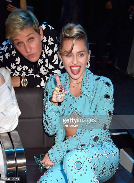 Miley Cyrus poses with Ellen DeGeneres during the 2017 MTV Video Music Awards at The Forum on August 27 2017 in Inglewood California