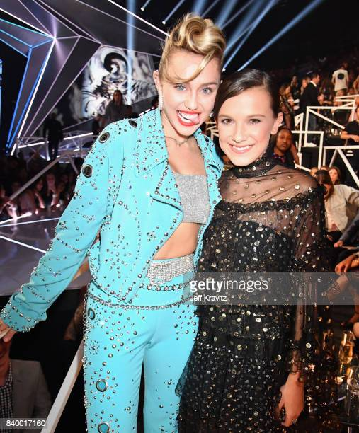 Miley Cyrus poses with Millie Bobby Brown during the 2017 MTV Video Music Awards at The Forum on August 27 2017 in Inglewood California