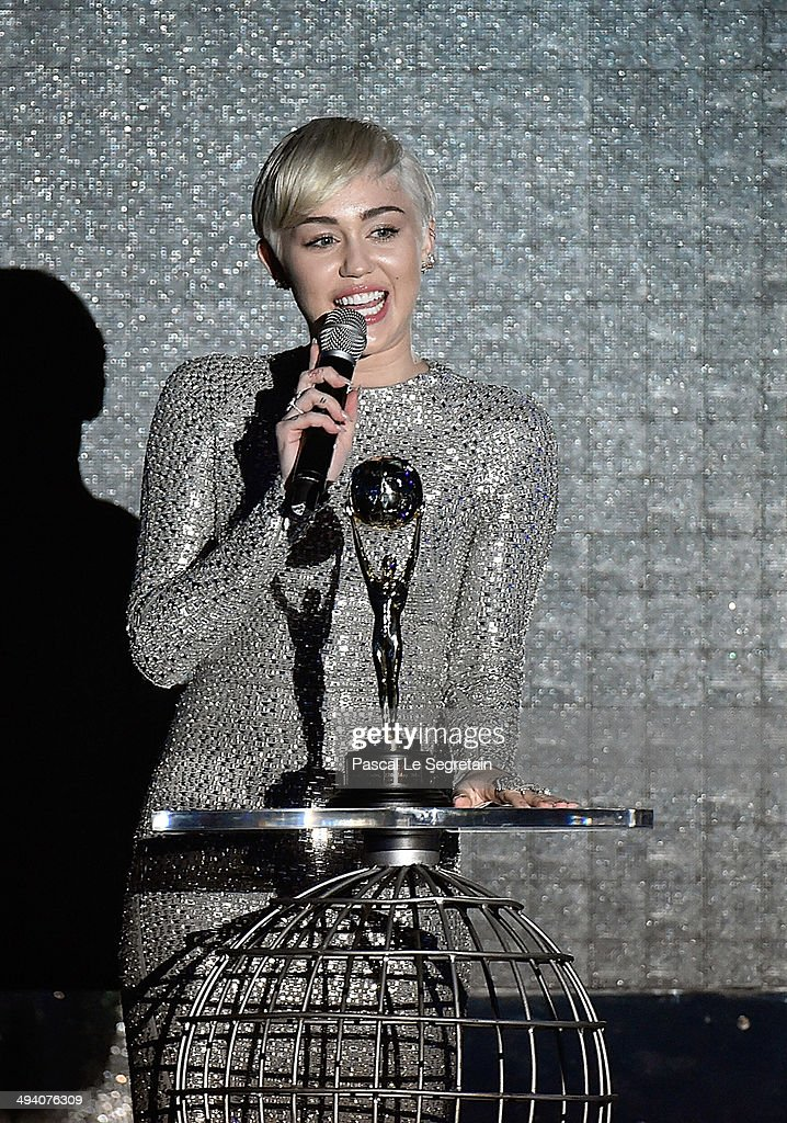 <a gi-track='captionPersonalityLinkClicked' href=/galleries/search?phrase=Miley+Cyrus&family=editorial&specificpeople=3973523 ng-click='$event.stopPropagation()'>Miley Cyrus</a> receives a award during the ceremony of the World Music Awards 2014 at Sporting Monte-Carlo on May 27, 2014 in Monte-Carlo, Monaco.