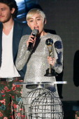 Miley Cyrus receives an award during the Ceremony of the World Music Awards at Sporting MonteCarlo on May 27 2014 in MonteCarlo Monaco