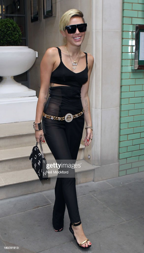 <a gi-track='captionPersonalityLinkClicked' href=/galleries/search?phrase=Miley+Cyrus&family=editorial&specificpeople=3973523 ng-click='$event.stopPropagation()'>Miley Cyrus</a> seen leaving her hotel on September 11, 2013 in London, England.