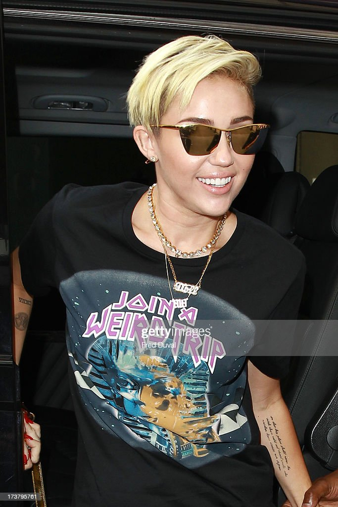 <a gi-track='captionPersonalityLinkClicked' href=/galleries/search?phrase=Miley+Cyrus&family=editorial&specificpeople=3973523 ng-click='$event.stopPropagation()'>Miley Cyrus</a> sighted outside BBC Radio One on July 18, 2013 in London, England.