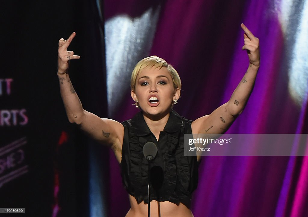 Miley Cyrus speaks onstage during the 30th Annual Rock And Roll Hall Of Fame Induction Ceremony at Public Hall on April 18, 2015 in Cleveland, Ohio.