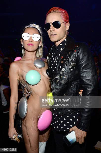 Miley Cyrus styled by Simone Harouche and Jared Leto attend the 2015 MTV Video Music Awards at Microsoft Theater on August 30 2015 in Los Angeles...