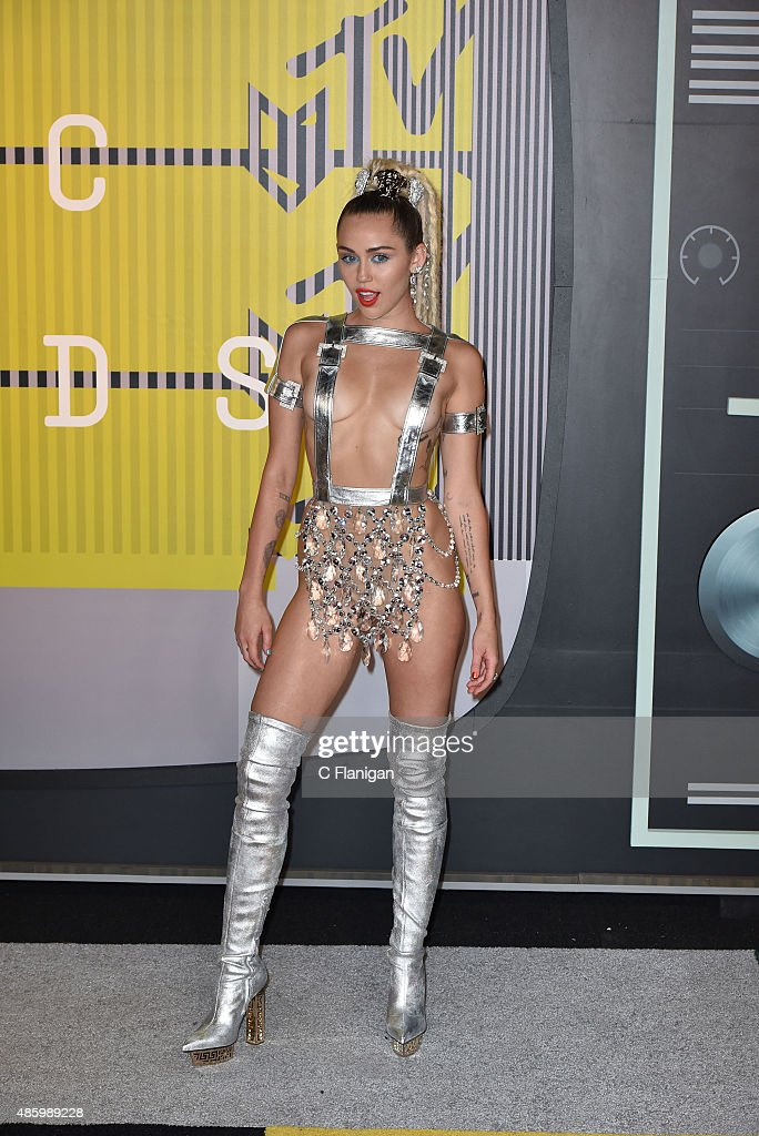 Miley Cyrus styled by Simone Harouche wearing a custom Versace outfit and boots arrives to the 2015 MTV Video Music Awards at Microsoft Theater on...