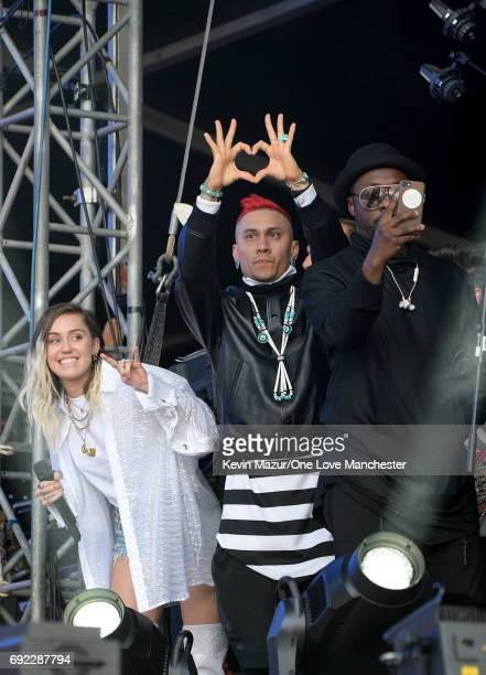 Miley Cyrus Taboo and william of The Black Eyed Peas on stage during the One Love Manchester Benefit Concert at Old Trafford Cricket Ground on June 4...