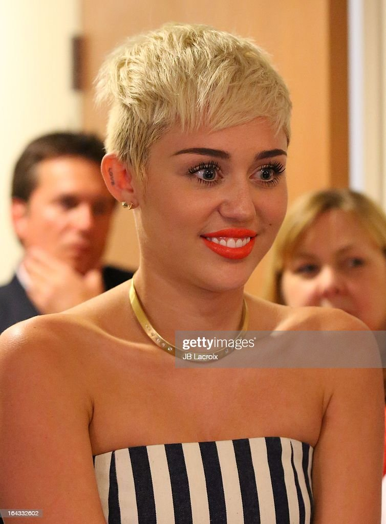 <a gi-track='captionPersonalityLinkClicked' href=/galleries/search?phrase=Miley+Cyrus&family=editorial&specificpeople=3973523 ng-click='$event.stopPropagation()'>Miley Cyrus</a> visits The Ryan Seacrest Foundation West Coast Debut Of New Multi-Media Broadcast Center 'Seacrest Studios' At CHOC Children's Hospital at CHOC Children?s Hospital on March 22, 2013 in Orange, California.