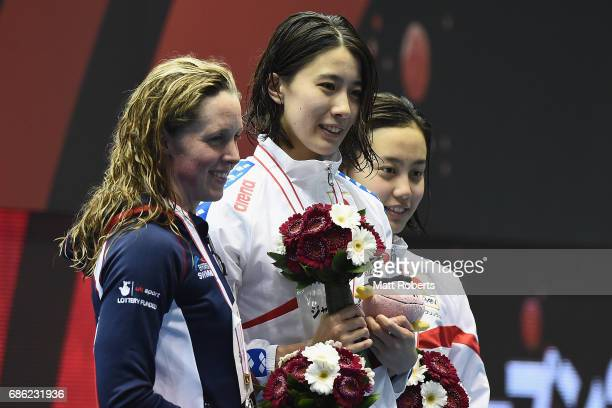 Miley Hannah of Great Britain Yui Ohhashi of Japan and Runa Imai of Japan pose with their medals on the podium after the 200m Individual Medley Final...