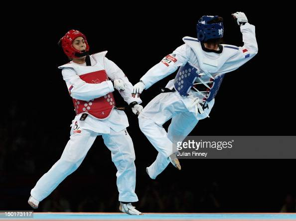 Milica Mandic of Serbia fights AnneCaroline Graffe of France in the Women's 67kg Gold medal match on Day 15 of the London 2012 Olympic Games at ExCeL...