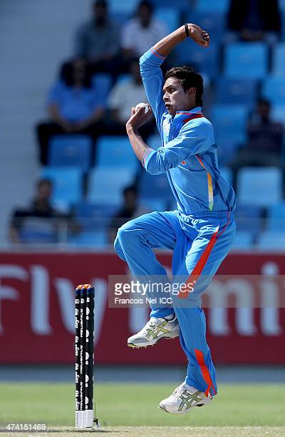 Milind of India bowls during the ICC U19 Cricket World Cup 2014 Quarter Final match between England and India at the Dubai Sports City Cricket...