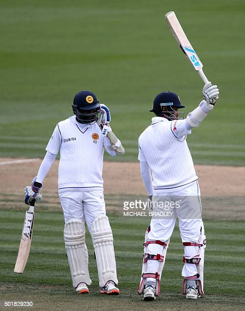 Milinda Siriwardana of Sri Lanka celebrates his 50 runs watched on by teammate Angelo Mathews during day one of the International Test cricket match...
