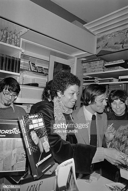 US militant Angela Davis signs the book about her biography 'Angela Davis l'Enchainement' written by Claude May on January 16 1978 at the Librairie...