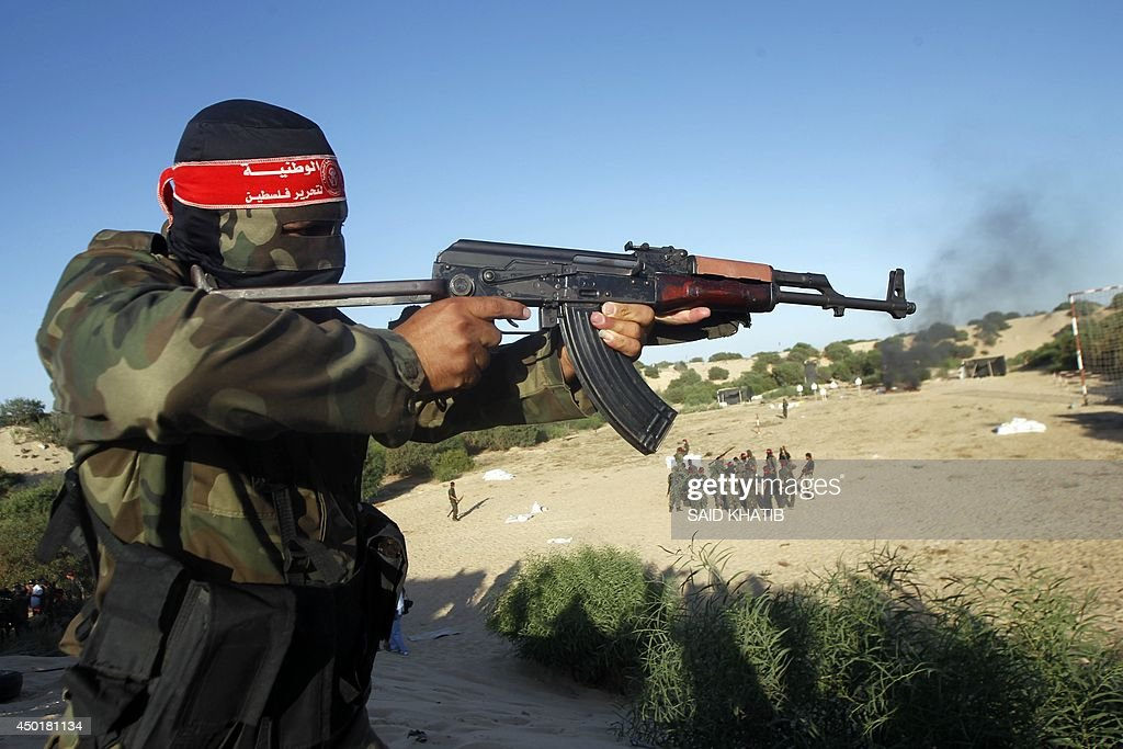 A militant from the Democratic Front for the Liberation of Palestine show off his skills during a graduation ceremony in Khan Yunis in the southern...