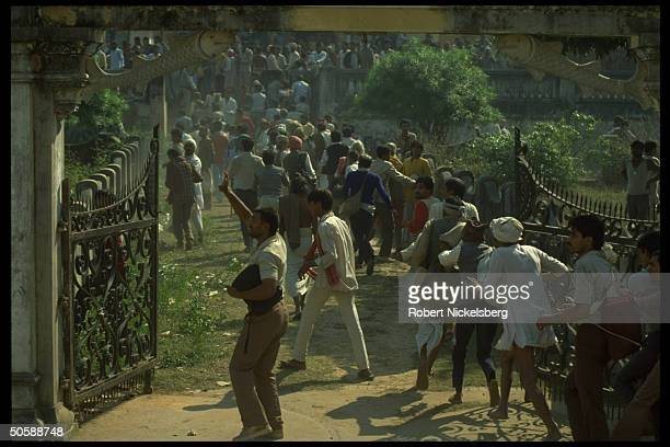 Militant Hindu activists on rampage rioting re razing Muslim mosque Babri Masjid erecting Hindu temple to godking Rama