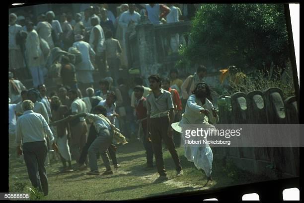 Militant Hindus on rampage rioting bent on razing Muslim mosque Babri Masjid erecting Hindu temple to godking Rama