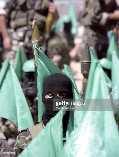 A militant of of Hamas movement attends the Friday prayers September 16 2005 in the former Netzarim Settlement in the Gaza Strip Militants from the...