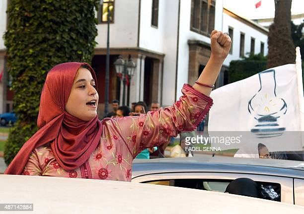 A militant of the Justice and Development Party gestures as she celebrates the results of Moroccan regional elections in the center of Rabat on...