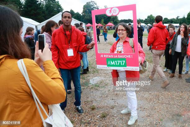 A militant poses for a picture as people gather to take part in a rally for the launch of a movement led by French Socialist member Benoit Hamon in...