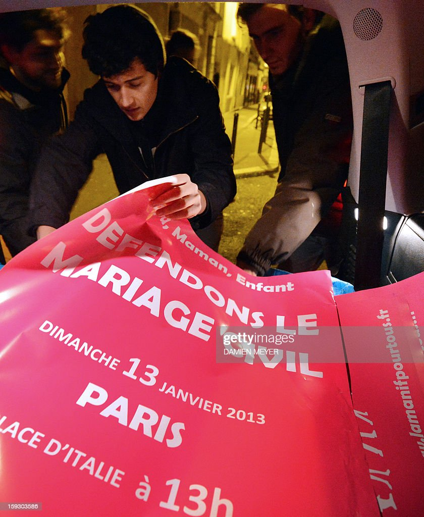 A militant prepares on January 11, 2013 posters reading 'Let's protect the civil marriage' and advertising for the national demonstration to be held in Paris on January 13 against the legalisation of gay marriage, prior to sticking them on billboards in the French western city of Nantes. Plans by France's Socialist government to extend marriage and adoption rights to gay couples have proven deeply divisive, igniting fierce protests from opponents including Catholic and Muslim leaders, with a new mass rally planned in Paris for January 13.