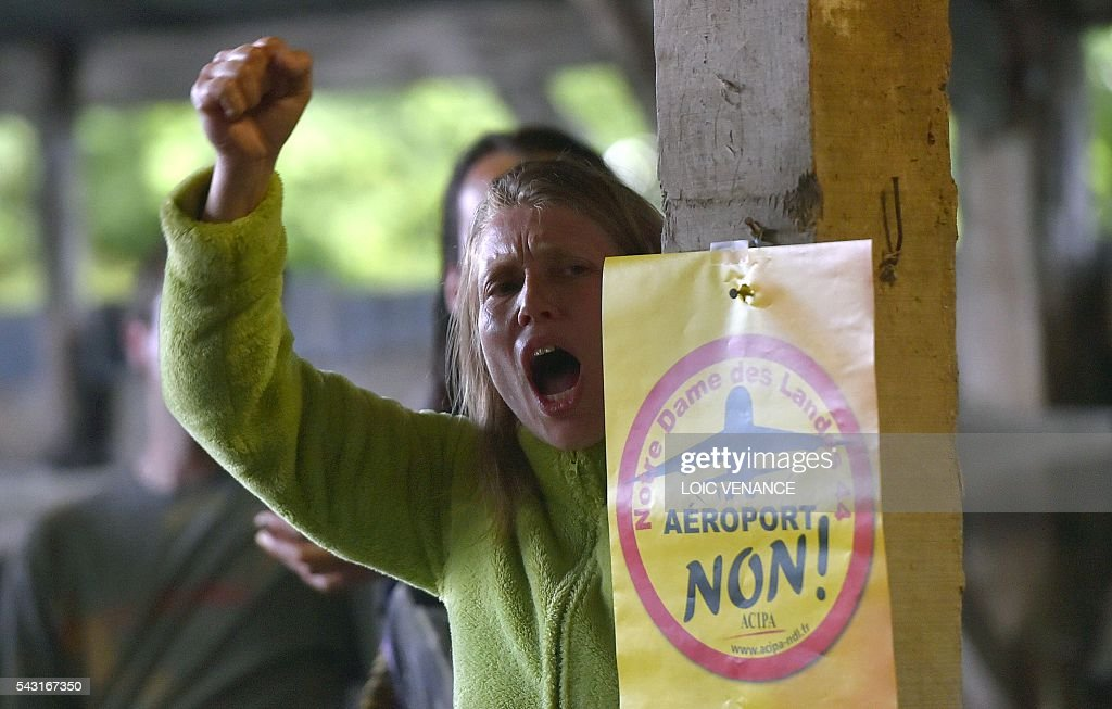 Militants against the Notre-Dame-des-Landes airport react at the Vache rit farm after the results on a local referendum organized in Loire Atlantique to transfer of the Nantes Atlantique airport to Notre-Dame-des-Landes, in Notre-Dame-des-Landes, on June 26, 2016. Nearly one million people living in France's Loire-Atlantique department voted in a referendum which poses the question 'Are you in favour of the project to transfer the Nantes-Atlantique airport to the municipality of Notre-Dame-des-Landes?' to voters. The referendum was organised by the French executive power hoping to find a solution to the issue which has dragged on for 50 years. / AFP / LOIC