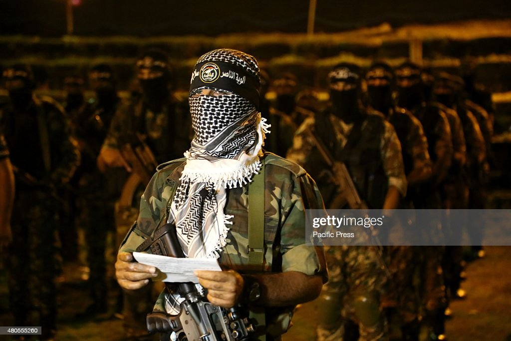 Militants from al-Nasser Salah al-Deen Brigade, the military wing of the Popular Resistance Committees march during an anti-Israel rally marking the first anniversary of the 50-day Israeli war on Gaza Strip last summer.
