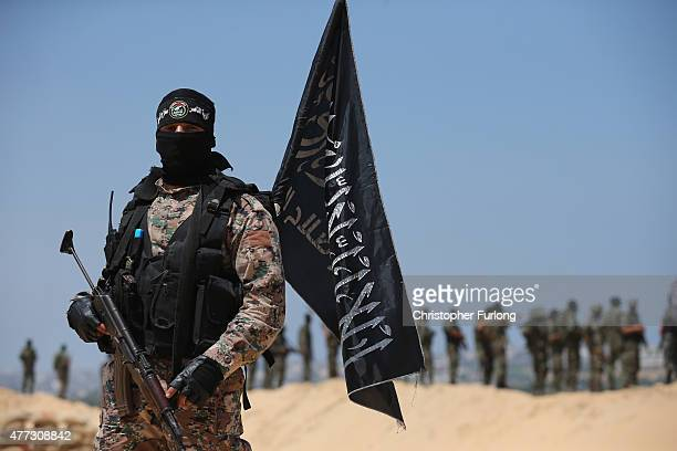 Militants from the alNasser Salah alDeen Brigades the military wing of the Popular Resistance Committees make a show of force on the border with...