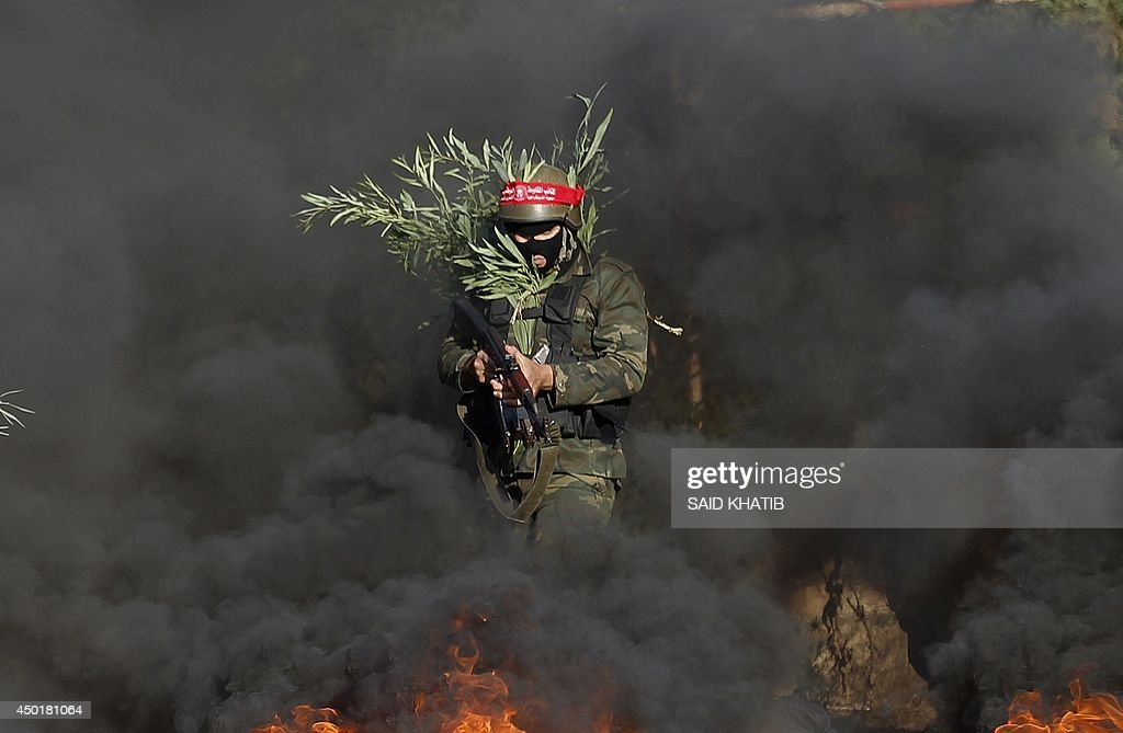 Militants from the Democratic Front for the Liberation of Palestine show off their skills during a graduation ceremony in Khan Yunis in the southern...