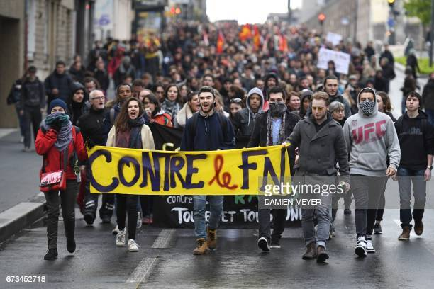 Militants hold a banner reading 'against the FN' as they demonstrate against the farright party National Front qualified for the second round of the...