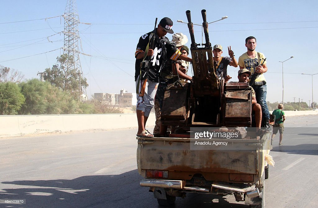 Militants of Fajr Libya coalition make an appearance at the entrance of the International Tripoli Airport after seizing the control of the airport...