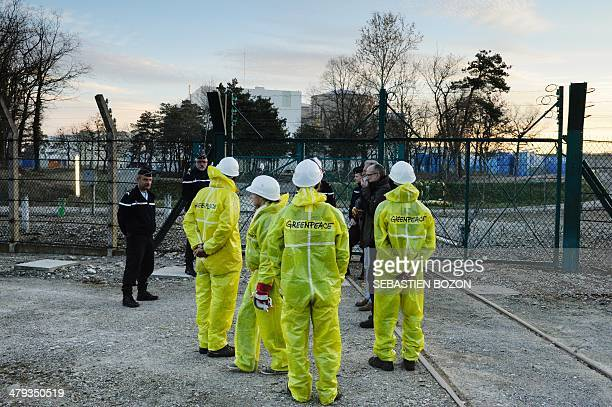 Militants of Greenpeace face policemen in front of the nuclear powerplant of Fessenheim Frances oldest atomic plant on March 18 2014 More than 60...