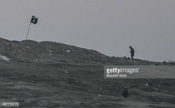 Militants of Islamic State are seen just before explosion of air strike on Tilsehir hill near Turkish border on October 23 at Yumurtalik village in...
