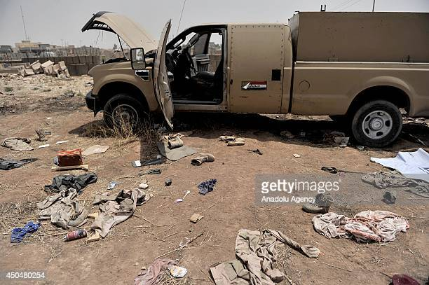 Militants of Islamic State of Iraq and the Levant damage the patrol car of Iraq army on the outskirts of Mosul Iraq on 12 June 2014