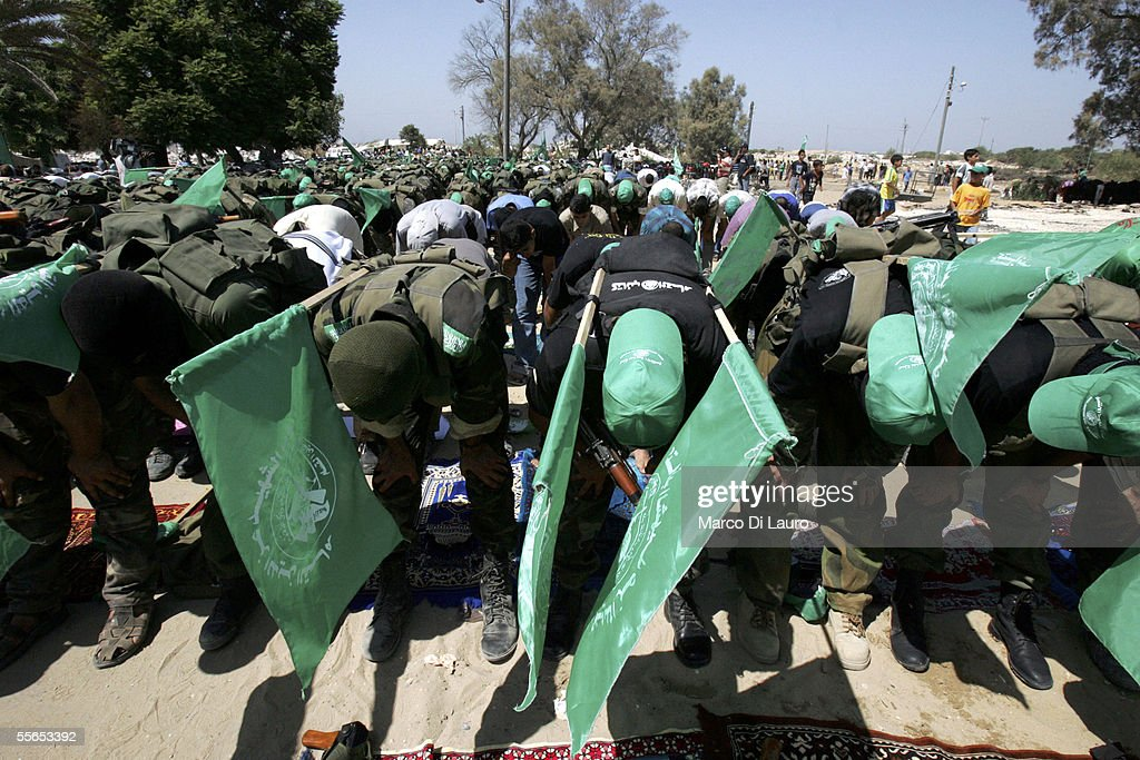 Militants of of Hamas movement bow during Friday prayers September 16 2005 in the former Netzarim Settlement in the Gaza Strip Militants from the...