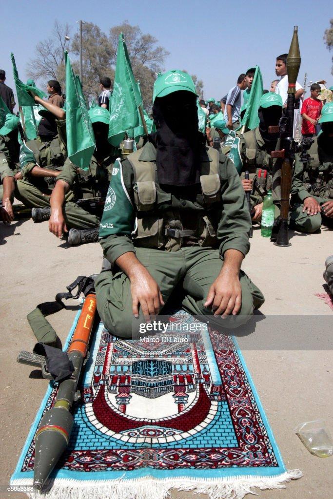 Militants of of Hamas movement pray during Friday prayers September 16 2005 in the former Netzarim Settlement in the Gaza Strip Militants from the...