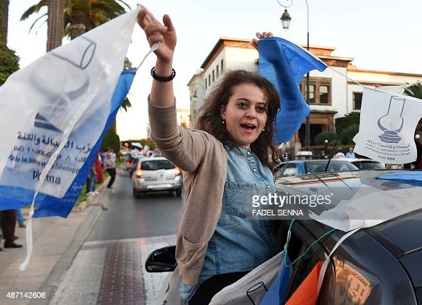 Militants of the Justice and Development Party wave party flags in the center of Rabat on September 6 after the results of Moroccan regional...