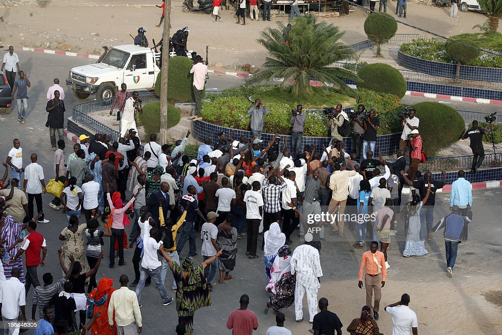 Militants of the PDS party demonstrate in front of the gendarmeria barracks on nNovember 22, 2012 as the son of Senegal's ex-president Abdoulaye Wade was released from police custody early Friday after lengthy questioning over graft allegations against him, a member of his entourage said. Mamadou Toure BEHAN