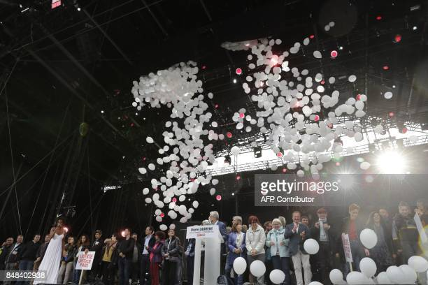 Militants sing on the stage of the 82nd edition of the annual 'Fete de l'humanite' music festival organized by French newspaper L'Humanite in La...