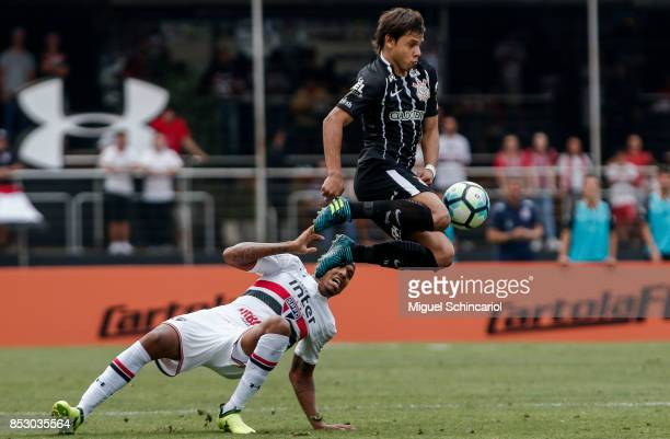 Militao of Sao Paulo vies for the ball with Romero of Corinthians during the match between Sao Paulo and Corinthians for the Brasileirao Series A...