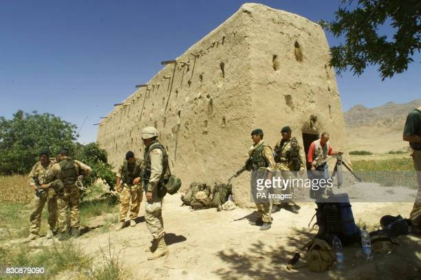 Military activity outside the mudbrick barn in Atalay village 50 miles northwest of Kandahar in southern Afghanistan where Royal Marines and US...