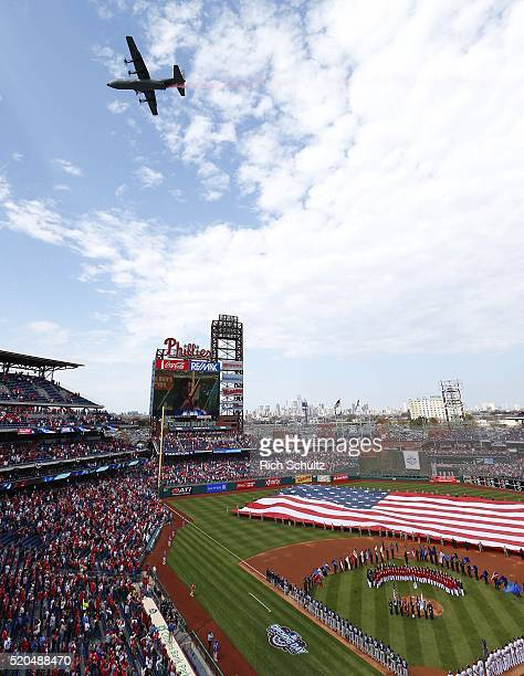 A military aircraft flies over during Opening Day ceremonies before the start of an MLB game between the San Diego Padres and Philadelphia Phillies...