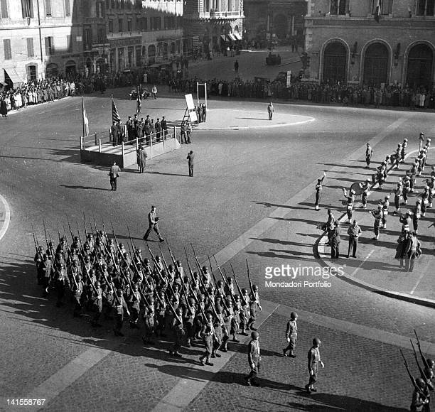 A military allied parade taking place before the authorities in Piazza Venezia in Rome on the occasion of the German surrender during the first world...