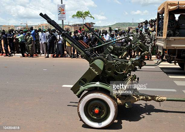 Military antiaircraft guns are driven past the official stand during a military parade on September 22 2010 in Bamako during celebrations marking 50...