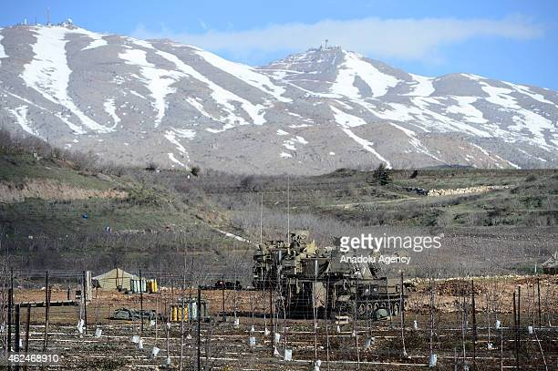 Military armored vehicles of Israel are seen near the border with Lebanon in the Israeliannexed Golan Heights on January 29 2015 Hezbollah attack on...