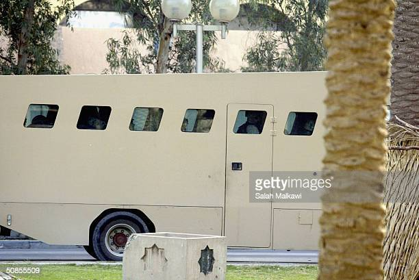 A military armoured bus arrives at the 'Green Zone' in Baghdad Iraq before arraignments began inside the 'Green Zone' for three soldiers charged with...
