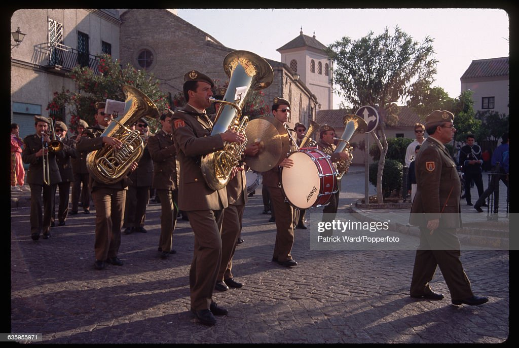 A military band attend a Holy Week procession at Castilleja de la Cuesta on Easter Sunday. Spain. | Location: Castilleja de la Cuesta, Spain.