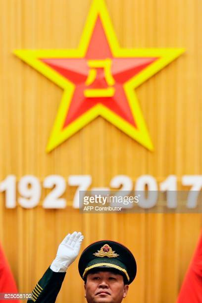 A military band conductor rehearses ahead of a ceremony to commemorate the 90th anniversary of the founding of the People's Liberation Army at the...