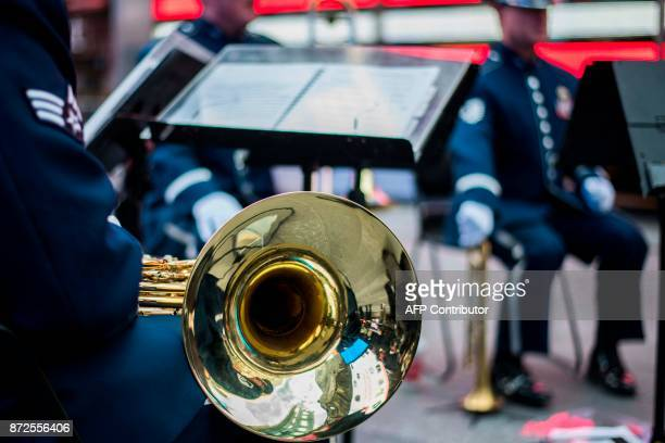 A US military band perform during the reopening ceremony of the renovated Times Square Recruiting Station in New York on November 10 2017 / AFP...